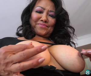 Mandy Thai is squeezing her tit while masturbating, because it feels much better like that