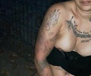 German tattooed girl fingers herself in public.
